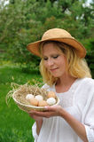 Young woman and Easter eggs Royalty Free Stock Photography