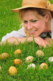 Young woman and easter eggs on the grass Stock Photography