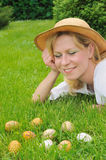 Young woman and easter eggs on the grass Stock Images