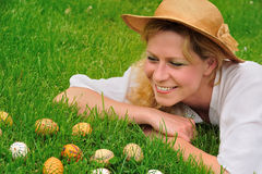 Young woman and easter eggs on the grass - Easter Royalty Free Stock Photos