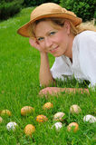 Young woman and easter eggs on the grass - Easter Stock Photo