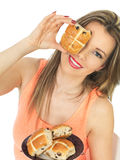 Young Woman With Easter Hot Cross Buns Stock Image