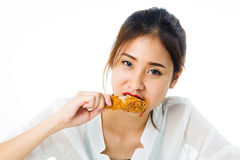 Young woman eat fried chicken Stock Photos