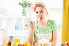 Young woman eat fruit salad Stock Photography