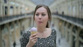Young woman eat ice cream stock video