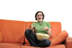Young woman eat popcorn and watching tv Stock Photography