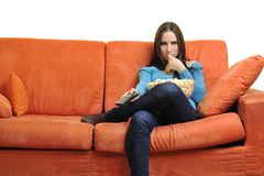 Young woman eat popcorn and watching tv Stock Image