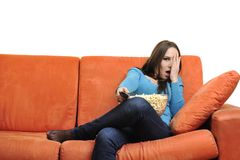 Young woman eat popcorn and watching tv Royalty Free Stock Image