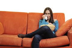Young woman eat popcorn and watching tv Royalty Free Stock Images