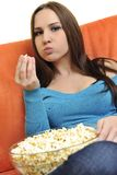 Young woman eat popcorn and watching tv Royalty Free Stock Photo