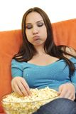 Young woman eat popcorn and watching tv Stock Photos