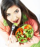 Young woman eat salad. Healthy vegetarian food. Young woman eat vegetarian food. Green salad Royalty Free Stock Photography