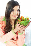 Young woman eat salad. Healthy vegetarian food. Stock Image