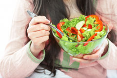 Young woman eat salad. Healthy vegetarian food. Royalty Free Stock Photos