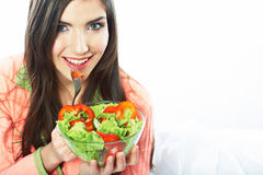 Young woman eat salad. Healthy vegetarian food. Royalty Free Stock Image