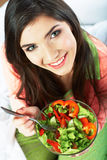 Young woman eat salad. Healthy vegetarian food. Stock Images