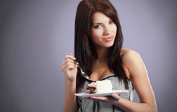 Young woman  eat  sweet cake Stock Photos