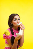 Young woman eat two cake - pin-up doll style Royalty Free Stock Photo