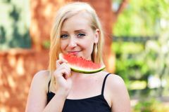 Young woman eat watermelon outside. Stock Photos