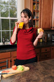 Young Woman Eating Stock Photography