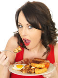 Young Woman Eating A Full English Breakfast Royalty Free Stock Images