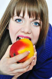 Young woman eating apple Royalty Free Stock Photography