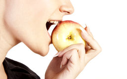 Young woman eating apple Stock Images