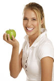 Young woman eating an apple Royalty Free Stock Photography