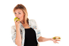 Young woman eating an apple Royalty Free Stock Photo