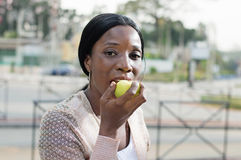 Young woman eating an apple. This young woman is eating an apple because it is nutritions Royalty Free Stock Images