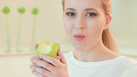 Young woman eating apple. Organic food stock video footage