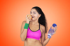 Young woman eating apple Stock Photos