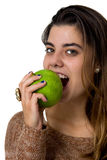 Young woman eating an apple Royalty Free Stock Image