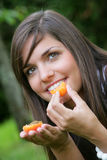 Young woman eating apricots Royalty Free Stock Images