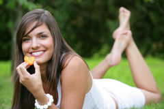 Young woman eating apricots Royalty Free Stock Image