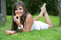 Young woman eating apricots Royalty Free Stock Photos