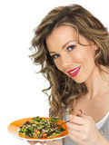 Young Woman Eating an Aromatic Salad with Mixed Beans and Wild Rice Royalty Free Stock Photography