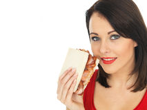 Young Woman Eating a Bacon Sandwich Stock Images
