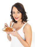 Young Woman Eating Baked Beans on Toast Royalty Free Stock Photo