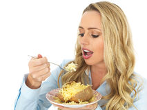 Young Woman Eating a Baked Potato with Cheese Stock Image