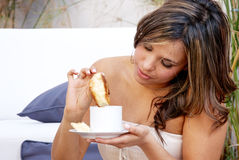 Young  woman eating batch Royalty Free Stock Image