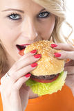 Young Woman Eating a Beef Burger Royalty Free Stock Image