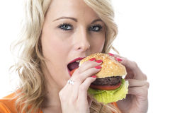 Young Woman Eating a Beef Burger Stock Image