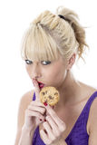 Young Woman Eating a Biscuit Stock Photo