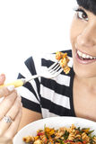 Young Woman Eating A Bowl of Colourful Vegetarian Tomato Pasta Royalty Free Stock Image