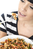 Young Woman Eating A Bowl of Colourful Vegetarian Tomato Pasta Royalty Free Stock Photos