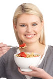Young Woman Eating Bowl Of Healthy Cereal Royalty Free Stock Images