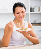 Young woman eating breakfast Royalty Free Stock Photography