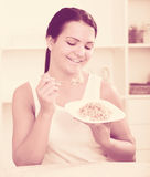 Young woman eating breakfast Stock Images