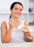 Young woman eating breakfast Stock Image